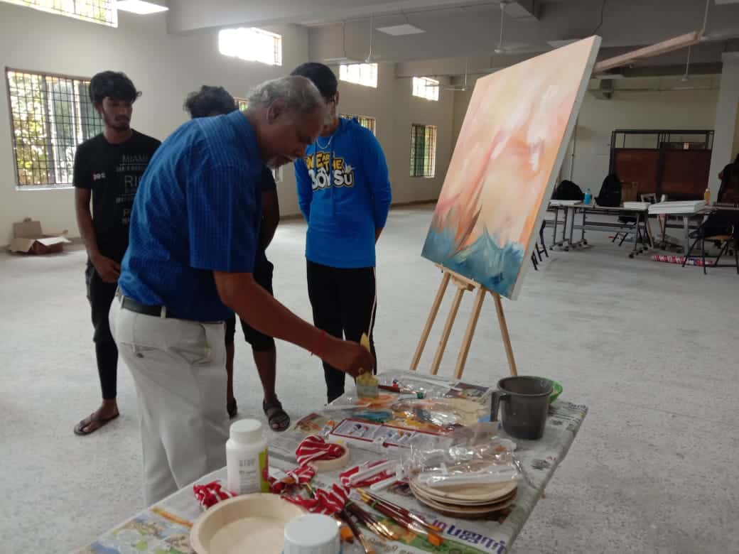 Faculty exhibiting his painting talent on the canvas board during artwork shop conducted at our design institute in chennai
